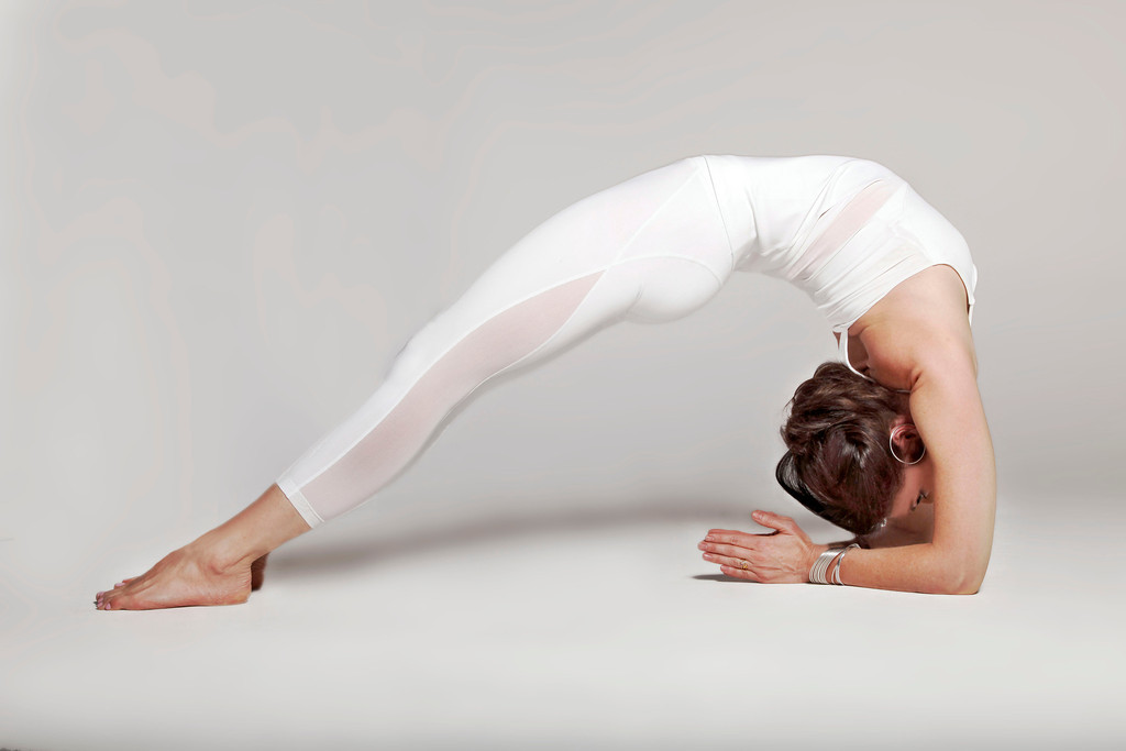 Sianna Sherman wearing the White Hot Summer Romance Yoga Collection!